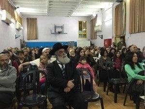 הרב יצחק פרץ ראש מערך הגיור, בכנס חנוכה של עמי